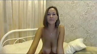 Sexy MILF showing her amazing tits on webcam