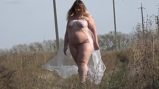 naked fat woman walks through a forest clearing