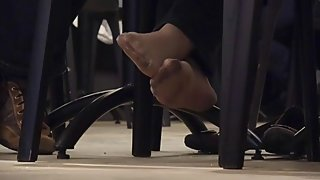 Hosed Lady Soles Under Table