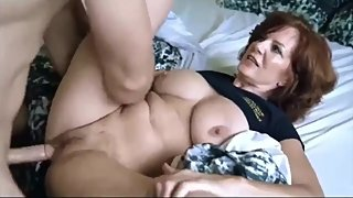 Sexy mature stepmom having fun with her stepson while nobody home