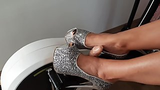 Silver High heels play with dildo in similator