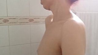 close up down up view of girl's sexy huge adam's apple in the shower