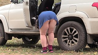 Mature BBW Outdoors Changing Clothes Near Car