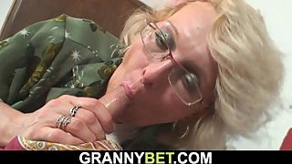 Shaved-pussy mature woman pleases an young dude