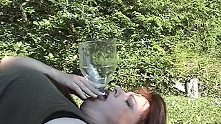 Tasha from idrinkpiss piss drinking from a funnel