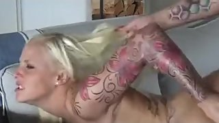 girl in a tight-fitting suit gives an ass and gives a blowjob